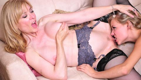 nicole ray lesbian porn Blonde  lesbians Nicole Victoria gets ready for the fuck on the silky couch nude.