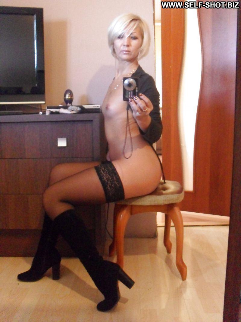 Horny milf in stockings spreads her legs to get black dicks 8