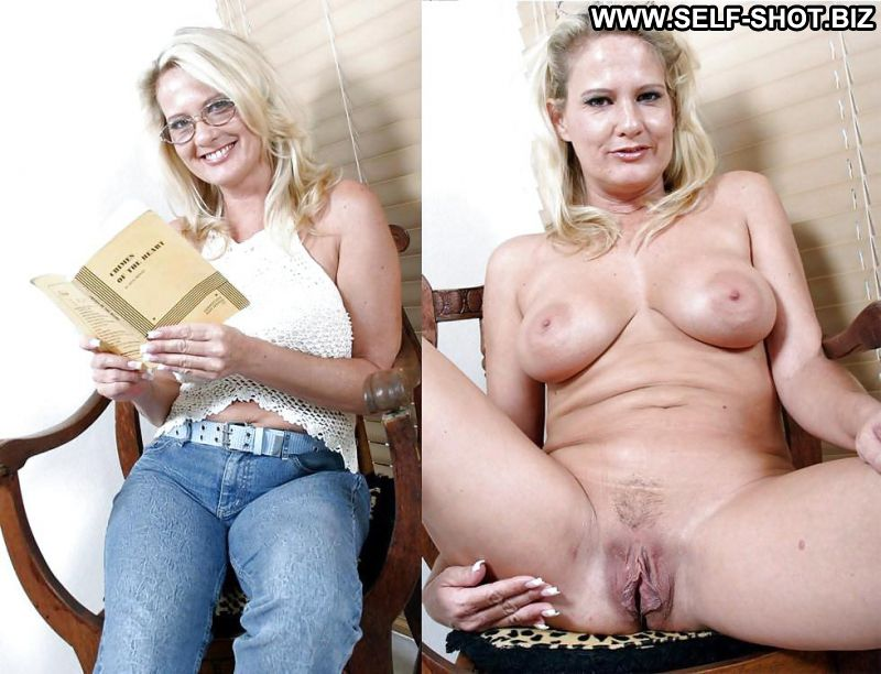Big titted milf undressing